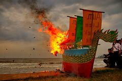Barongsai and Dragon boat burning. stock photo