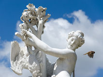 Baroque antique female statue and flying bird Royalty Free Stock Image