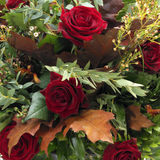 Baroque bouquet. Baroque fall bouquet with red roses and oak leaves Royalty Free Stock Images