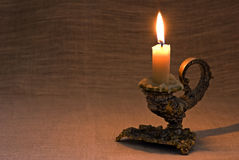 Baroque Candlelight. Holder as still-life on brown background stock image
