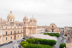 The baroque cathedral of Noto and the main street of the town Stock Photo