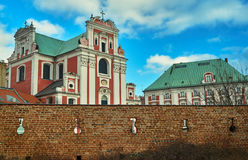 Baroque Catholic Church behind medieval defensive wall Royalty Free Stock Photo