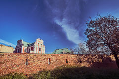 Baroque Catholic Church behind medieval defensive wall Stock Photo