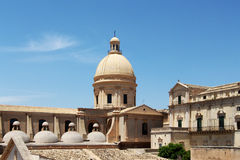 Baroque chatedral of noto, the restored dome. An overall view of the baroque chatedral of noto, with the restored dome, sicily, landscape cut Royalty Free Stock Photo