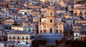 Baroque Church. A birdseye view of the Baroque Church surrounded by houses in Modica, Sicily Stock Photo