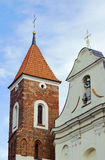 The baroque church with a Gothic tower Stock Image
