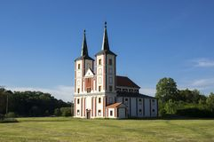 Baroque Church of St. Margaret, Chrast, Podlazice village, Czech republic, Europe. Meadow with church, two towers, mystic place, devils bible stock photography
