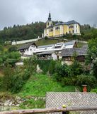 Baroque Church of St. Martin is located on a hill above the village of Srednja vas. Slovenia stock photography