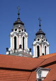 Baroque church. Two baroque church towers against clear blue sky in Vilnius, capital of Lithuania Royalty Free Stock Photography