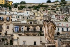 Stone statue outside the Duomo of Saint Peter in baroque town Modica, Sicily stock photo
