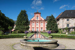Baroque Domdechanei reflecting in a pond. Fulda, Hessen, Germany Stock Photos