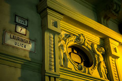 Baroque doorway in Bratislava. Partial view of a baroque doorway and adjacent street sign in Bratislava Stock Images