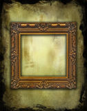 Baroque empty frame on grunge texture. Baroque golden frame on a grunge background stock photo