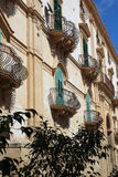 The baroque facade of a house in Noto in Sicily Stock Photography