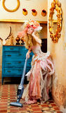 Baroque fashion blonde housewife vacuum cleaner. Baroque fashion blonde housewife woman at vacuum cleaner chores Stock Photos