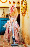 Baroque fashion blonde housewife vacuum cleaner. Baroque fashion blonde housewife woman at vacuum cleaner chores Royalty Free Stock Photography
