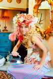 Baroque fashion blonde housewife woman iron chores. Baroque fashion blonde housewife woman with iron chores Stock Photos