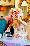 Baroque fashion blonde housewife woman iron chores Stock Images