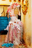 Baroque fashion blonde housewife woman mop chores Royalty Free Stock Image