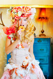 Baroque fashion blonde woman eating dona Royalty Free Stock Image