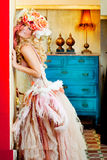 Baroque fashion blonde woman with flowers hat Royalty Free Stock Photography