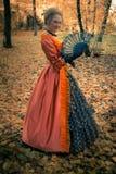 Baroque girl outdoor. Baroque girl in autumn park Stock Photography