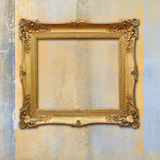 Baroque golden frame on a grunge faded texture Royalty Free Stock Photography
