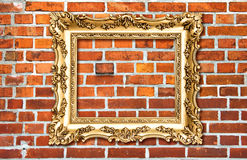 Baroque golden picture frame on red brick wall Royalty Free Stock Photos