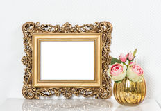 Baroque golden picture frame and rose flowers. Vintage style moc Royalty Free Stock Photo