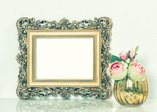 Baroque golden picture frame and rose flowers. Vintage style ton Royalty Free Stock Images