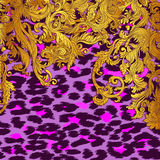 Baroque golden seamless pattern over leopard or cheetah skin tit Royalty Free Stock Image