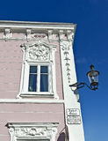 Baroque house front with white ornaments Stock Images