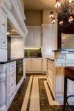 Baroque kitchen in huge apartment Stock Photos