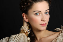 Baroque lady. Girl in baroque dress looking at camera Royalty Free Stock Photo