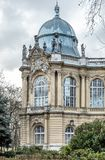 Baroque Landmark with Sculptures. Landmark with grey baroque dome and small sculptures of people, Budapest, Vajdahunyad Castle royalty free stock photos
