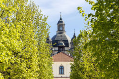 Baroque monastery through green trees Royalty Free Stock Photos