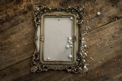 Baroque photo frame with pearls. Baroque photo frame with room on the antique table Stock Image