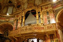 Baroque pipes organ. Organ of Della Consolata baroque church in Turin, Italy Royalty Free Stock Photos