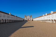 Baroque Sanctuary of Nossa Senhora do Cabo in Espichel Cape. View of the Church, and the Pilgrim lodgings. Sesimbra, Portugal Royalty Free Stock Images
