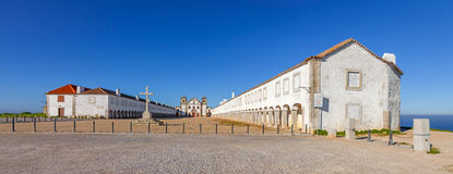 Baroque Sanctuary of Nossa Senhora do Cabo in Espichel Cape. View of the Church, the Pilgrim lodgings and stone cross. Sesimbra, Portugal Royalty Free Stock Images