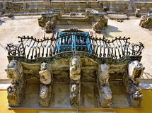 Baroque sculptures in Modica. Balcony with typical baroque sculptures in Modica, Sicily, Italy royalty free stock photos