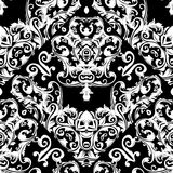 Baroque seamless pattern. Black floral ornate background wallpaper. White scroll leaves, flowers and vintage Baroque ornaments. In victorian style. Vector stock illustration