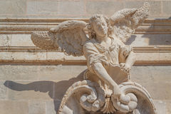 Baroque statue of angel decorating the facade of church Stock Photography