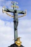 The baroque Statue of Jesus on Charles Bridge, Prague, Czech Republic Stock Images