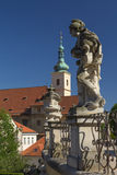Baroque staues and famous Church in Prague Royalty Free Stock Image