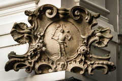 Baroque stone cartouche on the corner of the house in Bratislava Stock Image