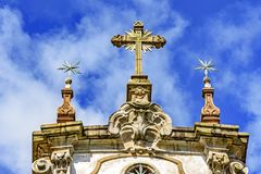 Baroque style crucifix and others ornaments on top of ancient and historical church Royalty Free Stock Images