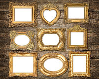 Baroque style golden frames over wooden background. Antique obje Stock Images