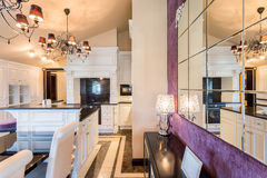 Baroque style kitchen. Connected with dining area Stock Photos