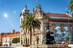 The Baroque twin churches Igreja das Carmeli and Igreja do Carmo with blue azulejo tiles and the Lion Fountain in the foreground royalty free stock images